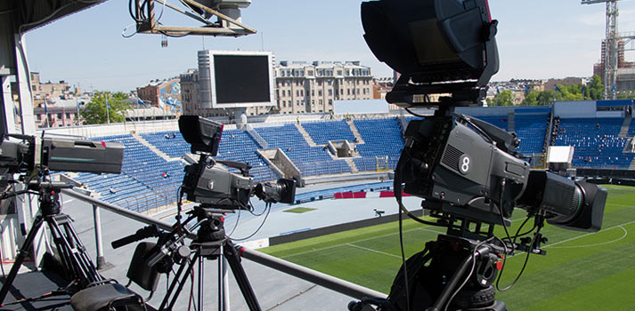 Broadcast cameras covering a soccer match