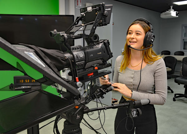 Girl using JVC ProHD cameras in the new tv studio of Rancho Buena Vista High School