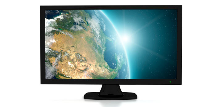 Sunrise on planet earth on a TV Screen
